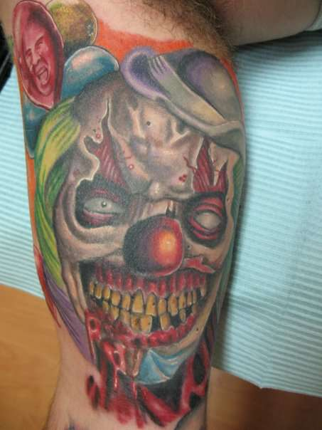 Smiling Clown Tattoo On Muscles