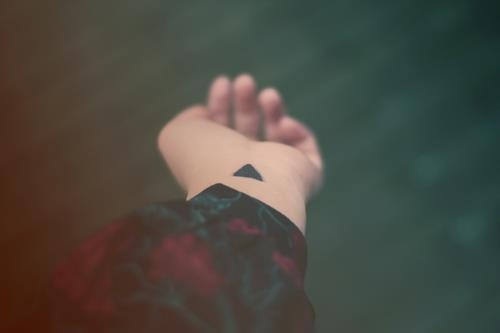 Solid Black Ink Hipster Triangle Tattoo On Left Inner Arm