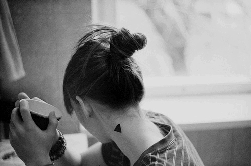 Solid Black Ink Triangle Tattoo On Left Side Of Neck