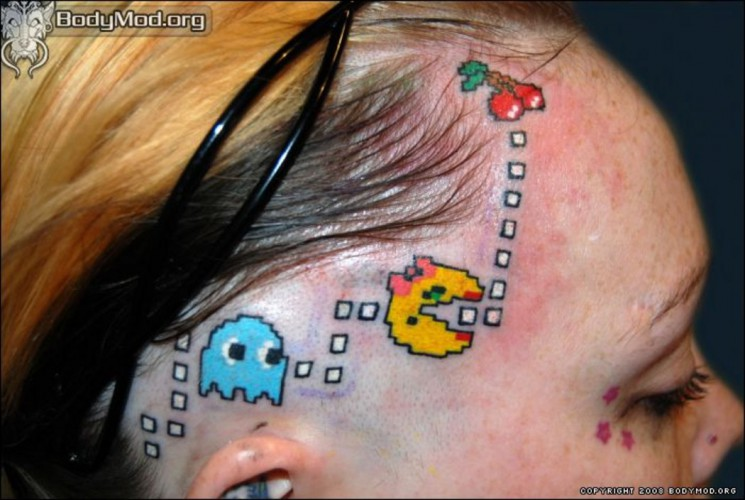 Sparkling Ripped Skin Video Game Tattoo Behind Right Shoulder