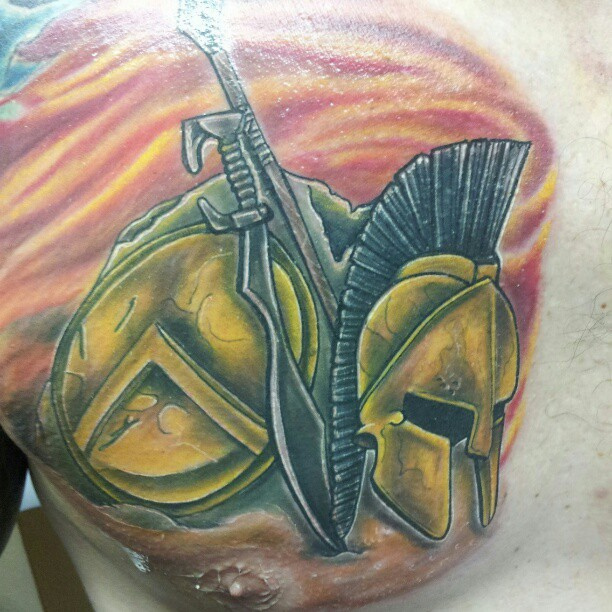 Spartan Helmet And Sword Tattoos On Chest