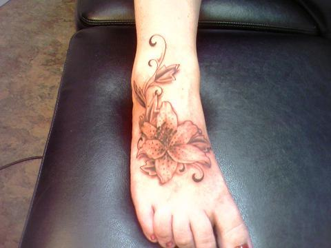 Sunflower Tattoo On Foot With Yellow Ink