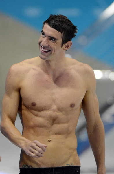 Swimmer With Olympic Rings Tattoo On Wrist
