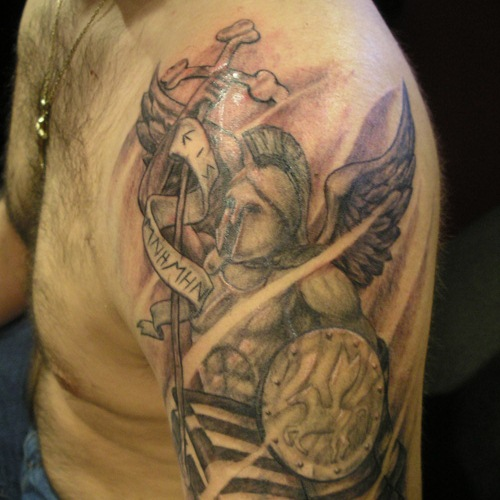 Sword With Grey Angel Wings Tattoo On Upper Arm