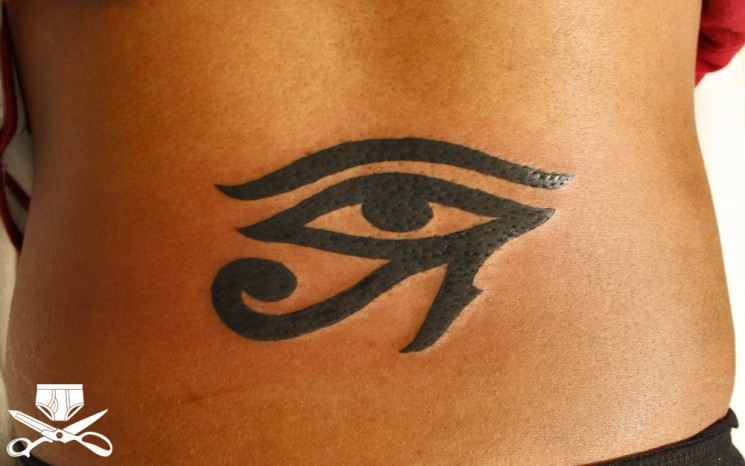 The Eye Of Horus Tattoo On Upper Back