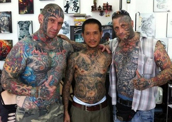 Three Dudes Covered In Full Body Tattoo Designs