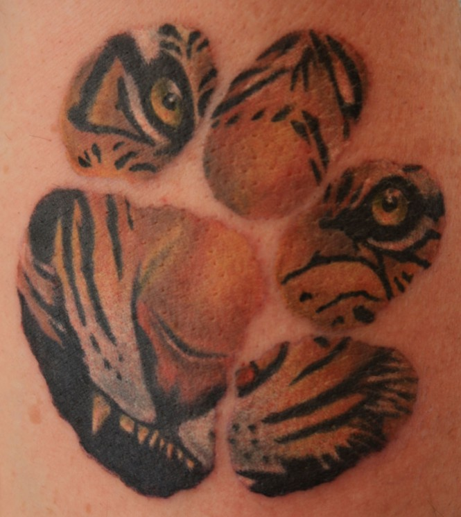 Tiger Claw And Writing Tattoos On Thigh