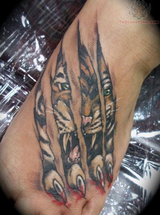 Tiger Ripped Skin Tattoo On Biceps