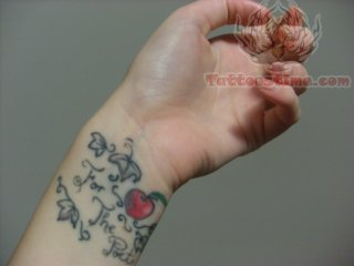 Tiny Apple Tattoo On Wrist For The Poets