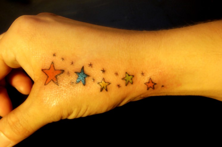 Tiny Black Stars And Colorful Ship Tattoo On Arm