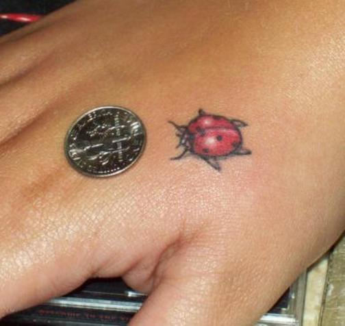 Tiny Lady Bug Hand Tattoo