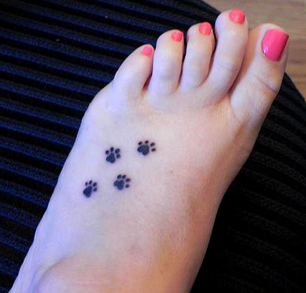 Tiny Paw Print Tattoos On Inner Ankle