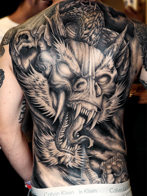 Tongue Out Old Viking Tattoo On Shoulder