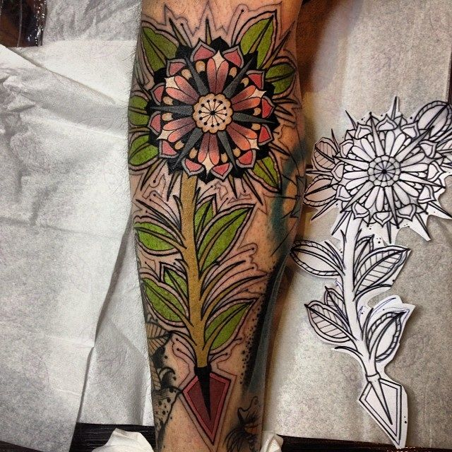 Traditional Arrow And Flower Tattoo