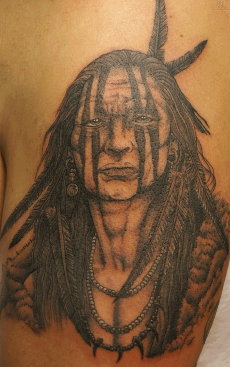 Traditional Indian Face Tattoo On Biceps