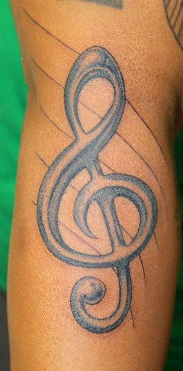 Treble Clef In Blue Wave Tattoos