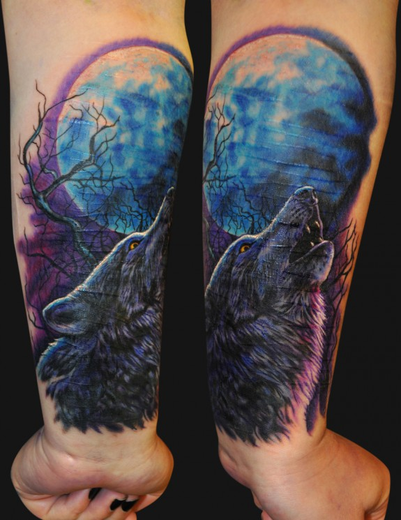 Tree And Howling Wolf Tattoos On Lower Arm