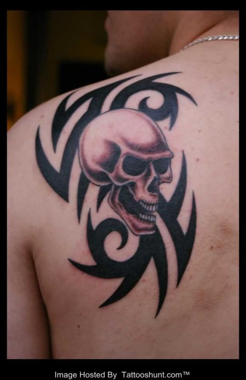Tribal And Skull Tattoos On Whole Back