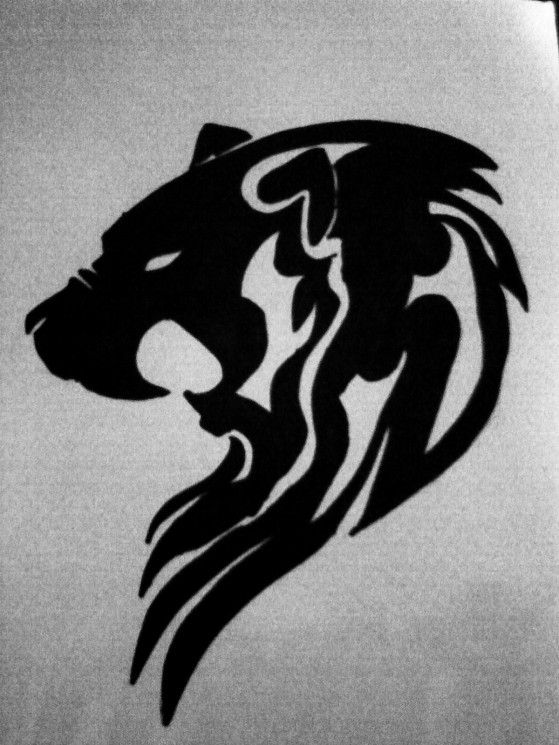 Tribal Angry Lion Face Tattoo Design