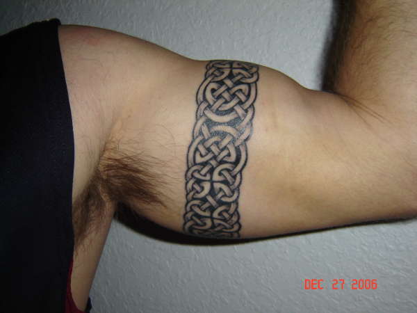 Tribal Armband Tattoo On Left Muscles