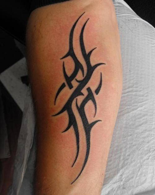 Tribal Libra Tattoo On Back Shoulder