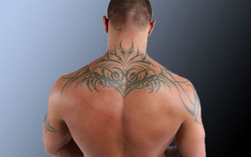 Tribal Style Sun Tattoo On Back Of Neck