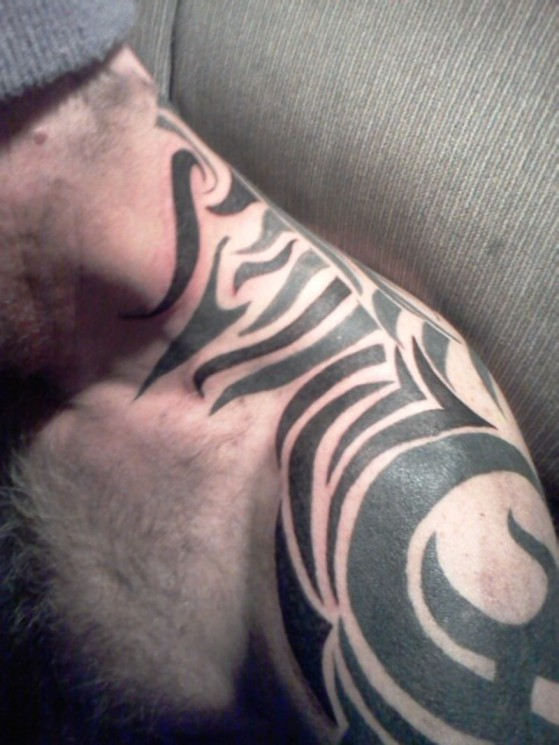 Tribal Tattoo On Neck To Shoulder
