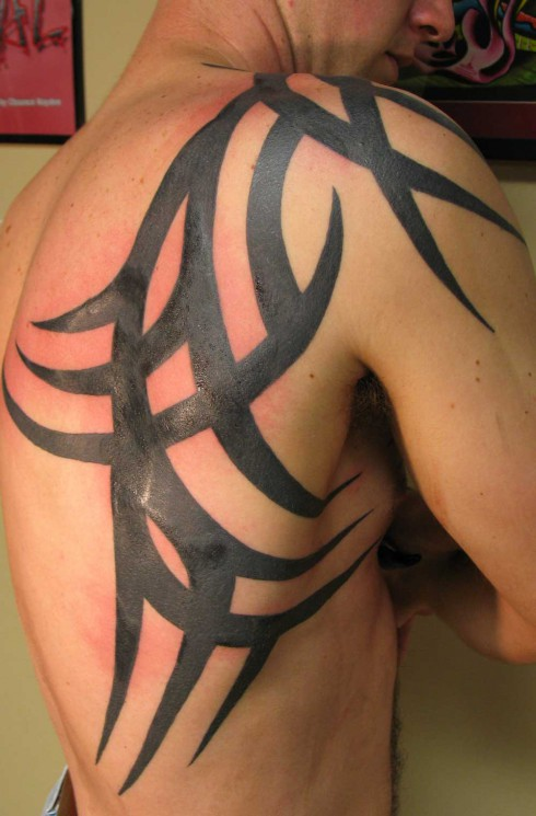 Tribal Tattoo On Stomach And Arms