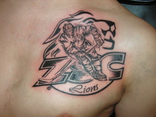 Truly Ultimate Sports Tattoo On Leg