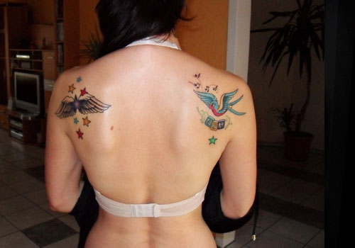Twin Blue Swallows Tattoos On Waist Of Girl
