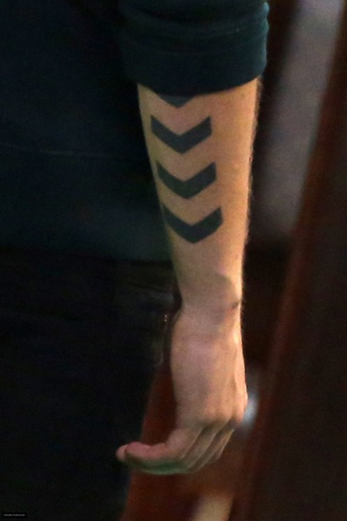 Twin Crossed Arrow Tattoos On Forearm