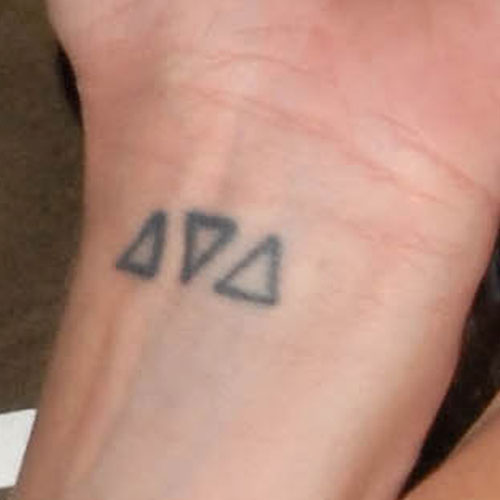 Two Outline Triangle Tattoos On Wrist