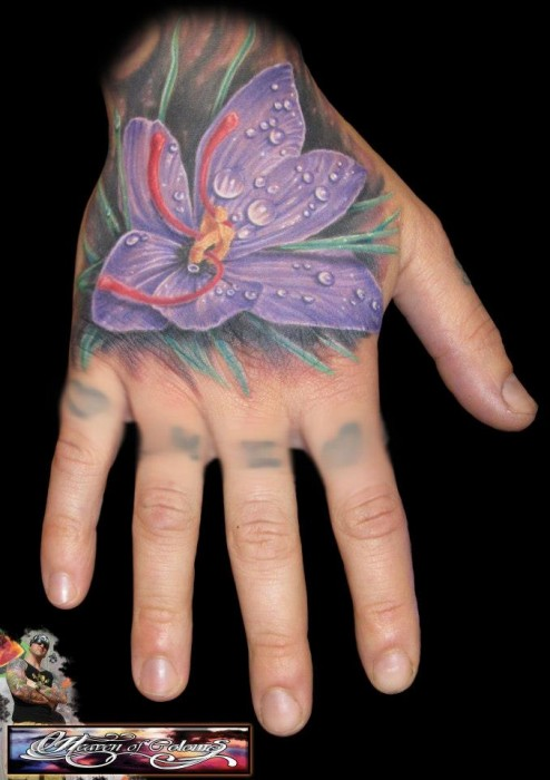 Unforgettable Purple Orchid Tattoo On Hand