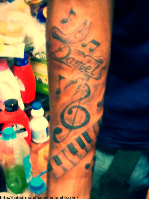 Violin Key And Piano Keys Tattoo On Right Arm