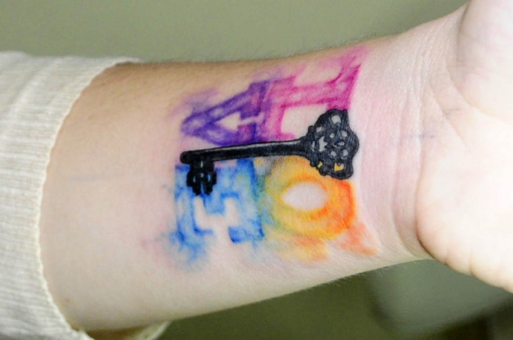 Watercolor Triangle Tattoos
