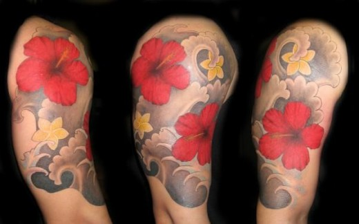 Waves And Flower Tattoos On Half Sleeve