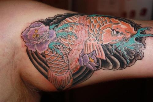 Waves And Koi Fish Muscles Tattoos