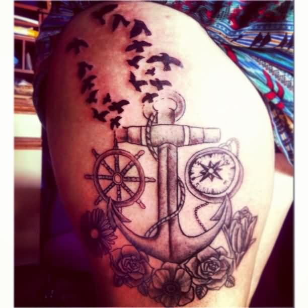 Wheel Anchor And Compass Tattoos On Thigh