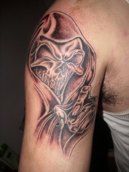 Wicked Grim Reaper Tattoo On Right Shoulder
