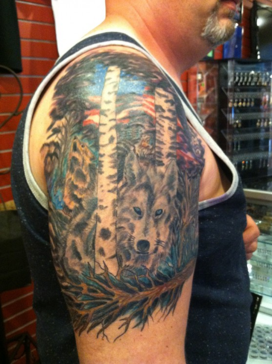 Wolf In Forest Tattoo On Half Sleeve