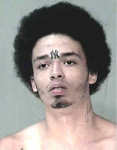 Woman With Gun Shot Hole Tattoo In Her Forehead