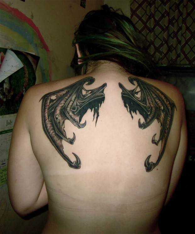 Writing And Wings Tattoos On Upper Back