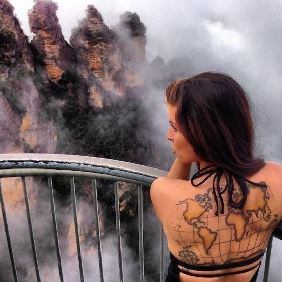 Young Girl With World Map Tattoo