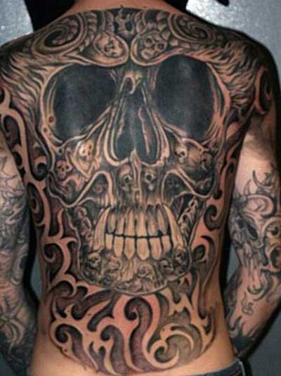 3D Evil Face Tattoos On Upperback photo - 2
