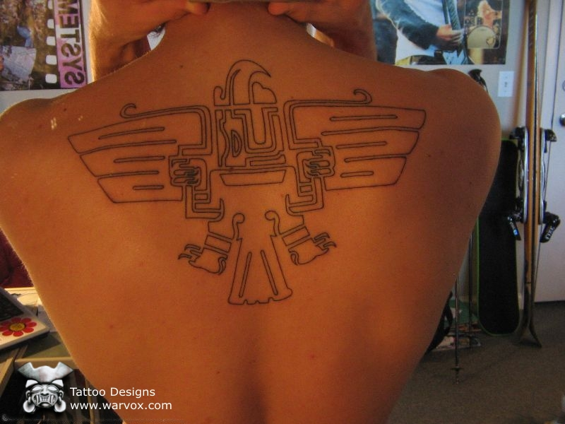 A Tribal Aztec Tattoo On Back photo - 1