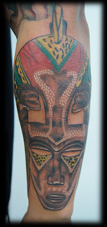 African Mask Tattoo On Arm photo - 3
