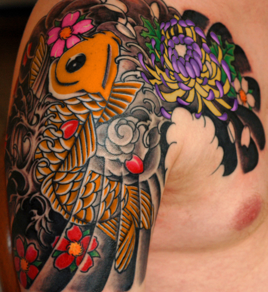 Amazing Sun Tribal Tattoo On Back Of Shoulder photo - 3