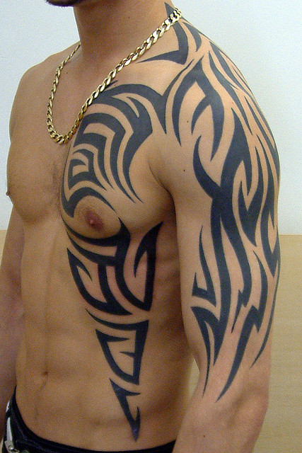 Amazing Tribal Tattoos On Chest And Arm photo - 1