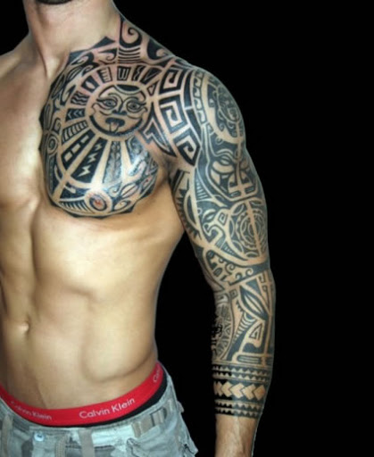 Amazing Tribal Tattoos On Chest And Arm photo - 2