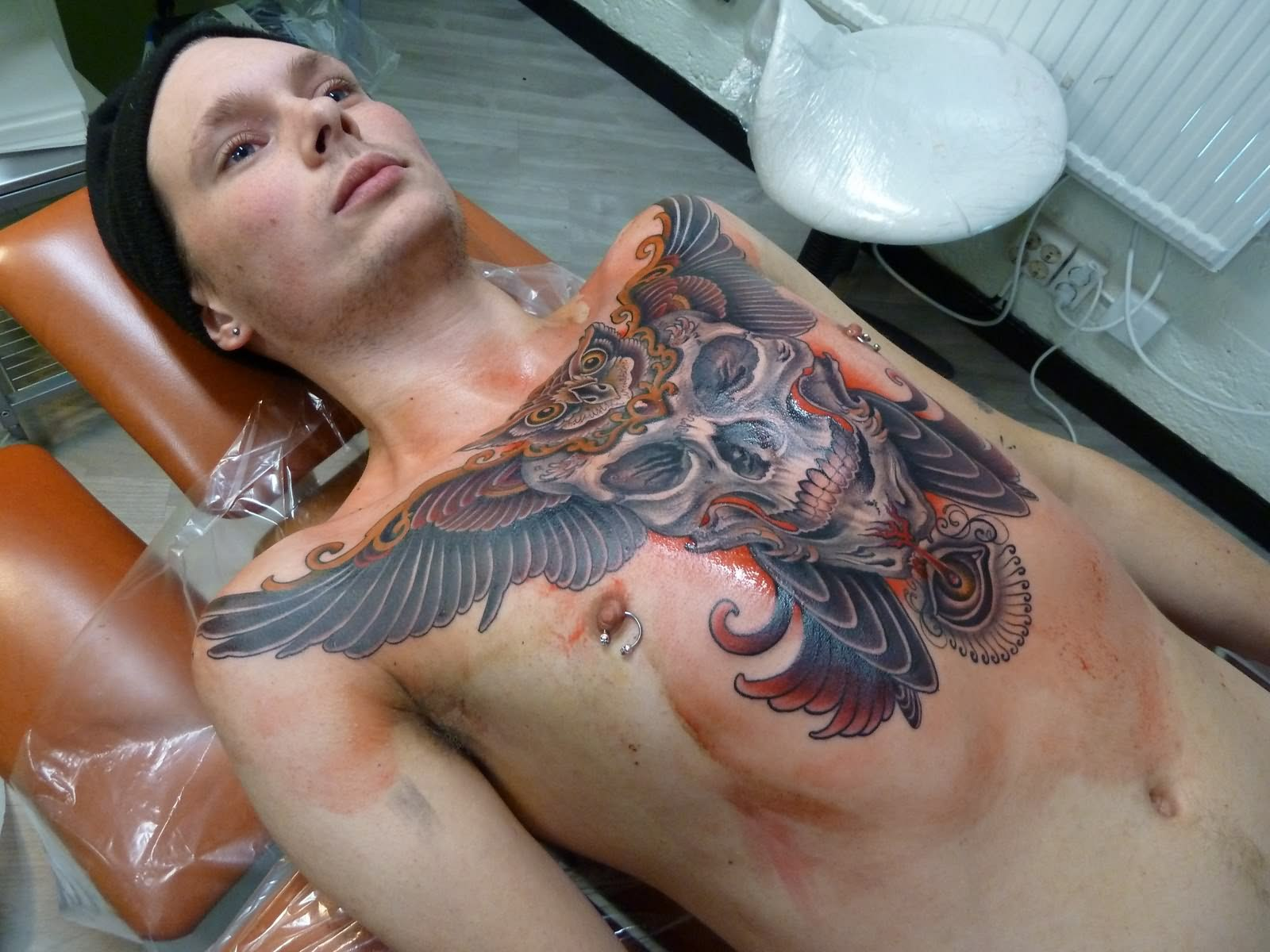 Angel Wings Crown Tattoo On Chest photo - 1